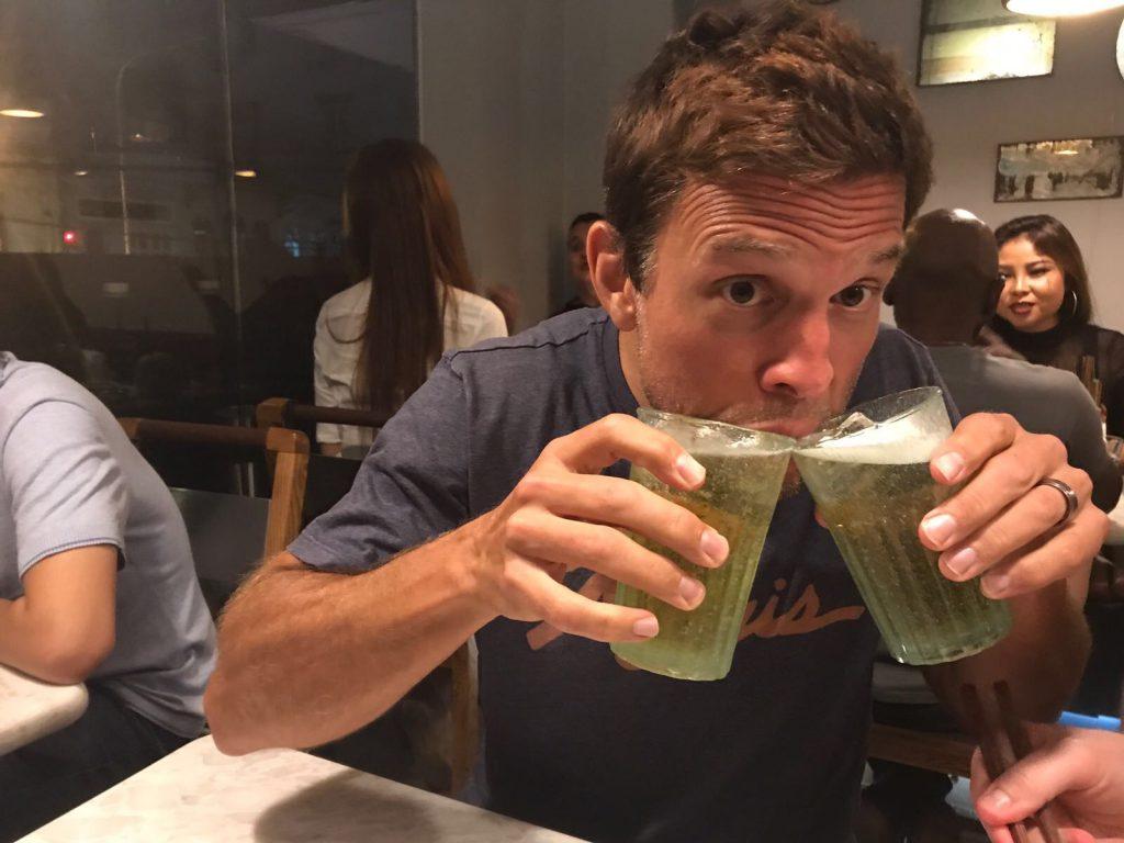 Steve drinking Vietnamese beer